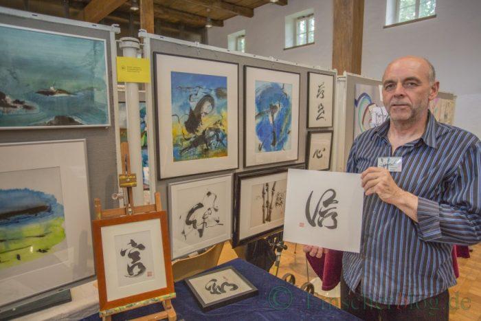 Der Dortmunder Johannes Rüther stellte seine Tusche- und Bambusmalerei im Bauhaus vor. Sein Weg zur chinesischen Malerei führte für ihn über die klassische chinesische Kalligraphie. (Foto: P. Gräber - Emscherblog.de)