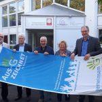 Klimaschutzflagge für Caritas: 100 Prozent Ökostrom