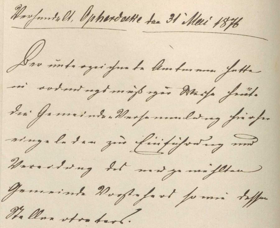 Auszug aus einem in Sütterlin geschriebenen Gemeinderatsprotokoll des Jahres 1876. (Quelle: Historischer Verein)
